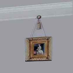Picture hanging from chair rail with rosette and tassel picture hook