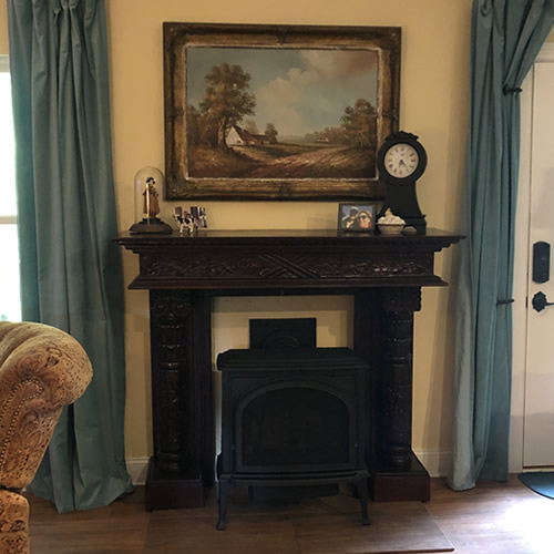The mantel over the fireplace before I painted behind it.
