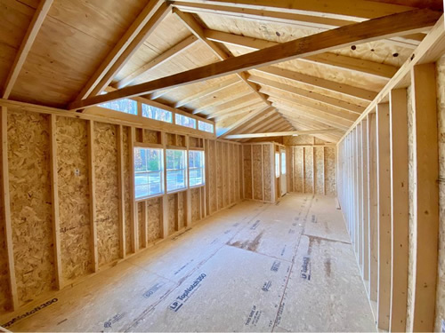12x32 Sheds By Design Ranch Cabin with the inside unfinished