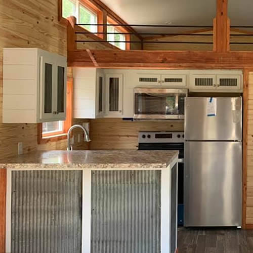 Kitchen with Galvanized Cabinet Details and Granite Countertop