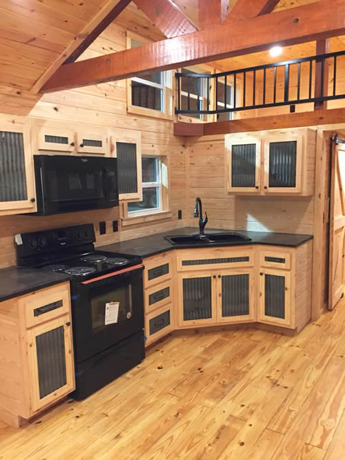 Autumn Breeze park model log cabin from Avery Cabin Co has a corner sink