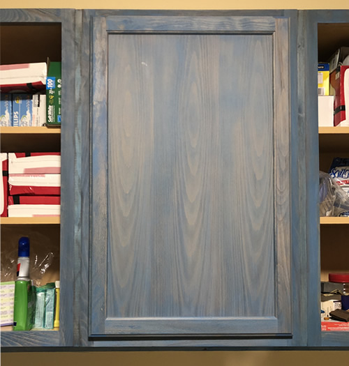 The first stained door and filling the cabinets