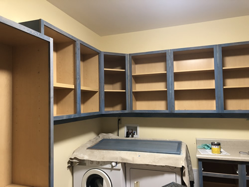 All of the outsides of the cabinets are stained and starting on the doors.