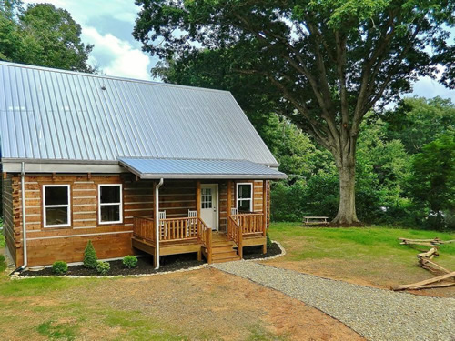 Averett Log Cabin Kit from Log Cabins for Less 2 Level, 2 Bedroom, 2 Bath, Includes Porch, 36′ long x 26′ wide, Total Living 1,251 sq ft