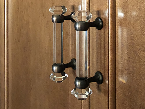 Cosmas 6393ORB-C faceted handles in clear with Oil Rubbed Bronze finish