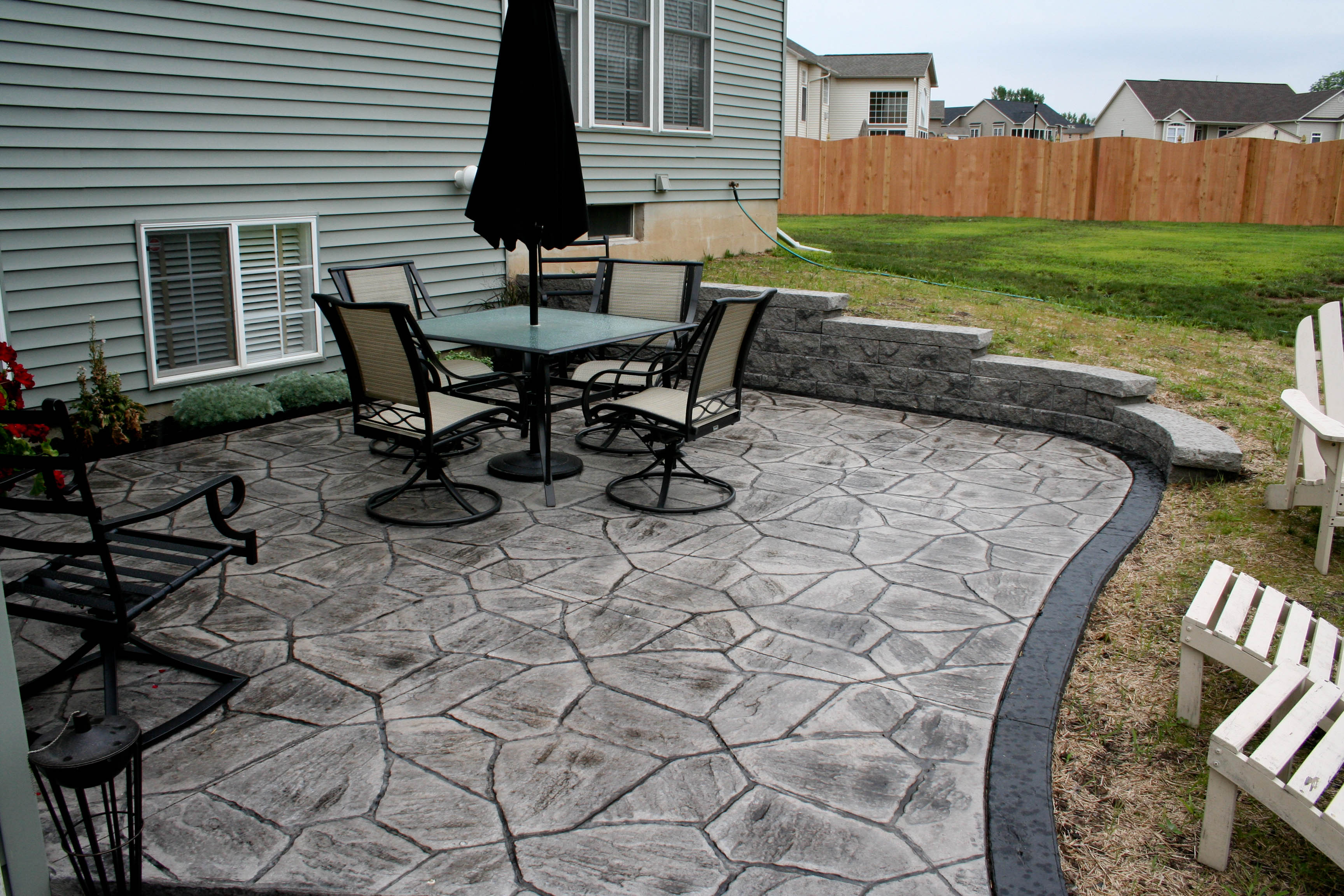 Stamped Concrete   ProLawn & Landscaping on Concrete Slab Backyard Ideas id=40547