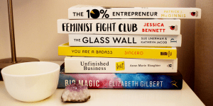 Stack of books that have been, and could be, discussed in PropelHer's Book Club for ambitious women