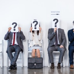 4 jobseekers sitting on chairs ready to use apartment manager job interview tips during an interview