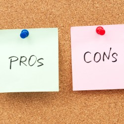 Two Note Pads on Cork Board For Pros and Cons of Flat Roofing Systems Blog Header