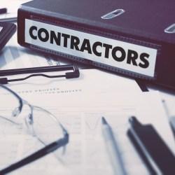 Approved Vendor Lists Inside Binder Labeled Contractors On Desk