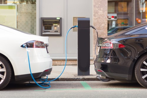 Two Electric Vehicles Charging At Commercial EV Charging Stations