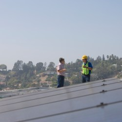 Two Roofers On Rooftop During Fall Roof Inspections for Commercial Properties