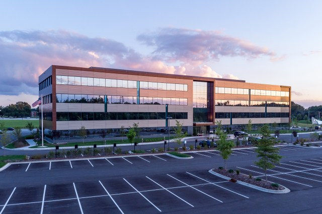 Mid Rise Class A Office Building and Parking Lot At Sunset That Can Benefit From Six Tips for Preventive Maintenance of Commercial Property Properties
