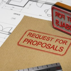 Request For Proposal Stampe On Folder and Construction Plans for Finding Qualified Third Bidders Blog Post