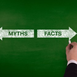 Valet Trash Myths vs. Facts On Green Chalkboard With Arrows