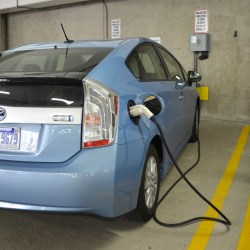 Electric Vehicle Chargng At EV Charging Station In Commercial Parking Garage