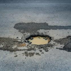Damaged Asphalt Requiring Commercial Pothole Repair Services