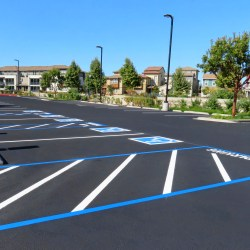 Sealed Parking Lot With Handicap Parking Spaces Showing Benefits of Sealcoating Commercial Parking Lots