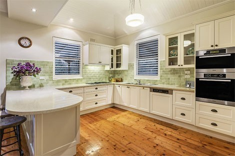 Kitchen style is in keeping with the period, retaining the polished floor boards, tiled splashback and windows don't feel out of place; glass doored cupboards are a period touch, well done!
