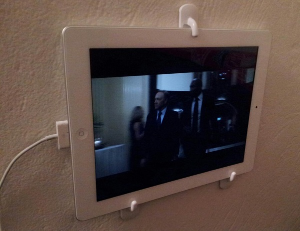 Use wall hooks to attach iPad to the wall.