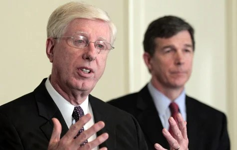 Iowa Attorney General Tom Miller, left, speaks as North Carolina Attorney General Roy Cooper, right, listens at a news conference at the National Association of Attorneys General spring meeting on March 7, 2011, in Washington. The attorneys general, along with several federal agencies, sent the largest mortgage servicers a proposal last week related to the servicers' foreclosure abuses last week. (Luis M. Alvarez/AP Photo)