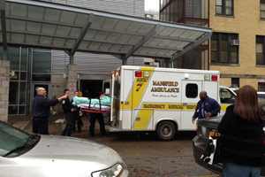 EMS units take patients as Coney Island Hospital evacuates on Oct 30. (Sheri Fink)
