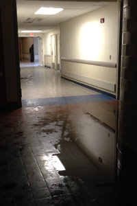 A flooded hallway at Coney Island Hospital on Oct. 30. Evacuations continued into the night on Oct. 31, according to a health official. (Sheri Fink)