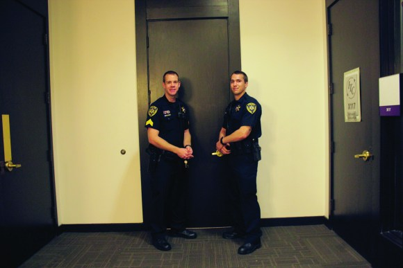 Photo by Zonghui Li | The Prospectus Public Safety sergeant Matthew Kopmann (left) and officer Scott Granitz (right) monitor the hallways on Tuesday, Sept. 8, 2015. Public Safety officers make sure doors to ongoing classes are closed to insure the safety of students