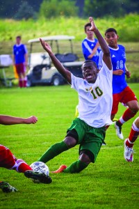 Photo by Scott Wells/Prospectus News Parkland Midfielder Daniel Kadima encounters a slide tackle during the match against Heartland on Sep. 2, 2015.  The Cobras beat the hawks by a score of 6-1.