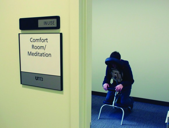 Photo by Zonghui Li | The Prospectus Parkland student Robert Johnston rests his head while waiting to get a massage in the Comfort/Meditation Room, located in Student Life, on Friday, Oct. 16, 2015.