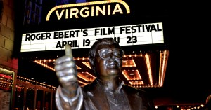 Photo by Lindsay Cox | The bronze statue of Roger Ebert is seen outside the Virginia Threatre in downtown Champaign during the 19th Ebertfest.