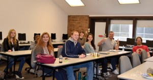 Photo by Lindsay Cox | Students of Christina Haveland's (back, center) French course pose for a photo during class.
