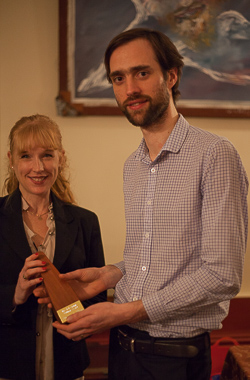Last year's winner Catherine Cashmore hands over the EJ
