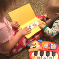 Kids reading and playing together