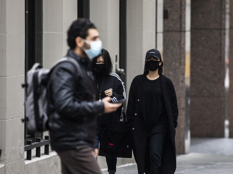 Facial recognition firms are scrambling to see around face masks
