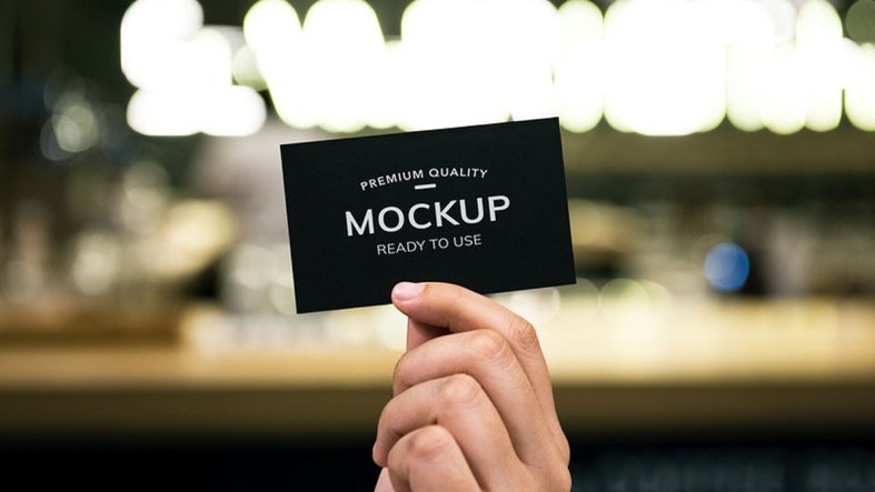 Closeup-of-hand-holding-black-paper-card---295932