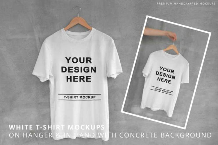 White T-Shirt on Hanger with Concrete Background B6DDBLV