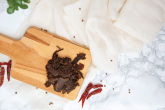 Biltong on a wooden board