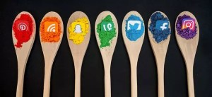 spoons with different social media sites on each