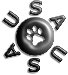 USAUSA logo, with name encircling a button-like disc with a pawprint carved out of the center, all in a 3–D black with light shining from the 1:30 position