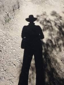 shadow hat man