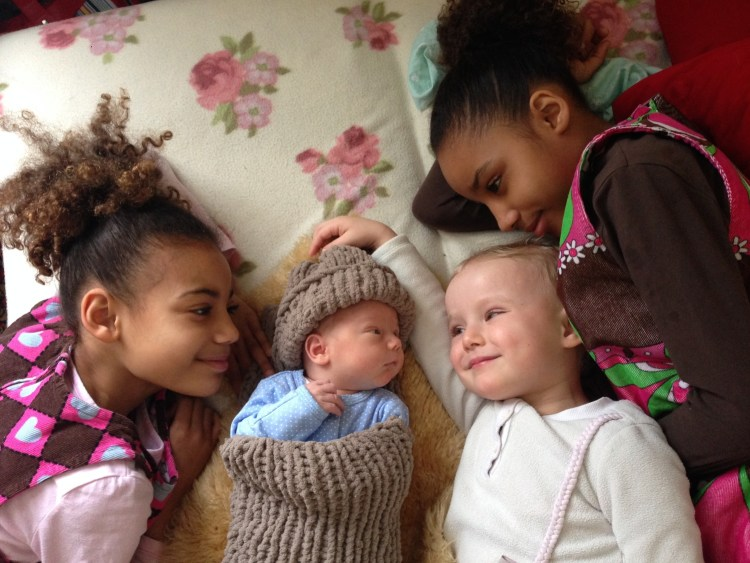 The kids with the newborn Artico