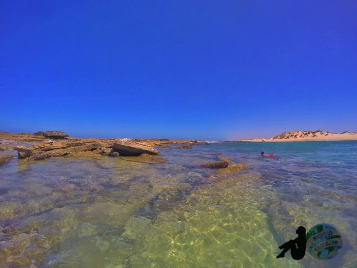 The crystal clear water and stunning back drop!