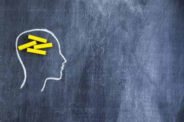 brain concept human head with yellow chalks