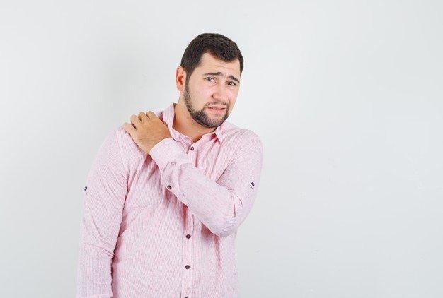 man having shoulder pain