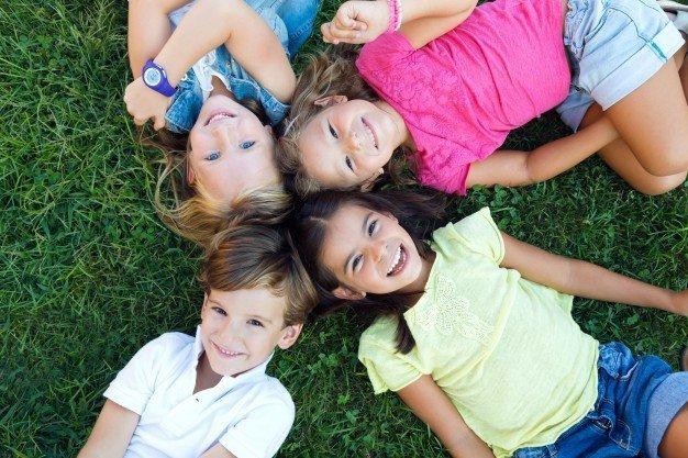 children lying in the grass