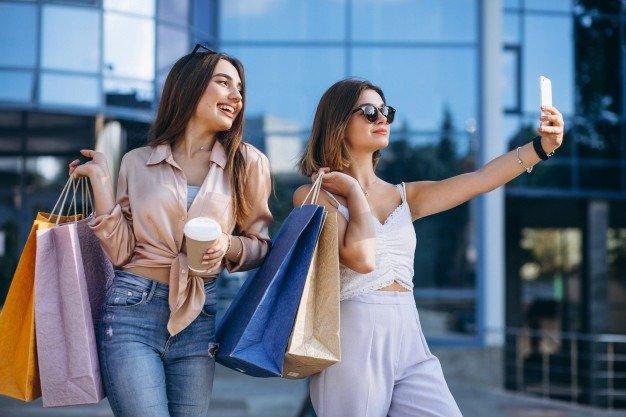 two women doing shopping