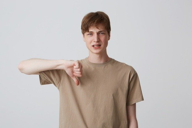 young man doing thumbs down