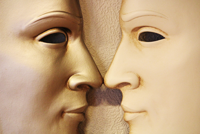 Two masks staring at each other. Can we get along?