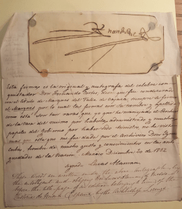 Hernán Cortes signature, with notation in Spanish below signed by Lucas Alaman, and notation below in English. Paper is yellowed and shows creasing and wear.